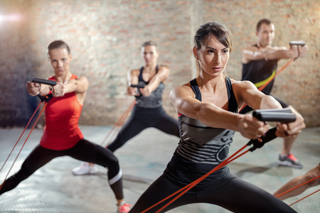 group exercising with a resistance band Stock Photo