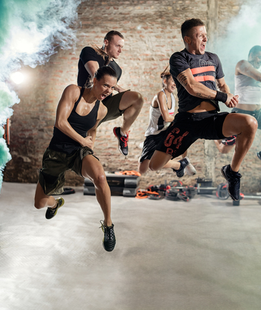Group of people jumping and practicing cardio fitness exercise Reklamní fotografie