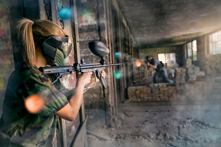 opposite: Paintball opposite teams in shootout Stock Photo