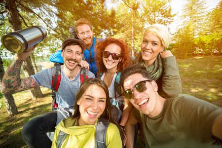 group of friends: Group of hikers takes photo in nature