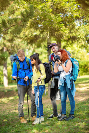 scouts: Young scouts makes pause in nature to take pictures and view path