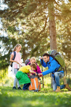 mountaineering: hiker family mountaineering in forest Stock Photo