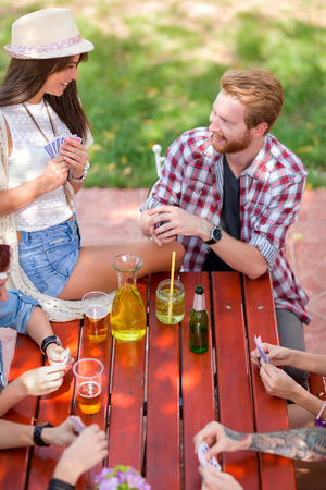 cute guy: Guy look cute girl with sympathy while playing cards in nature Stock Photo