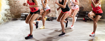 attractive woman: muscle female legs on fitness training