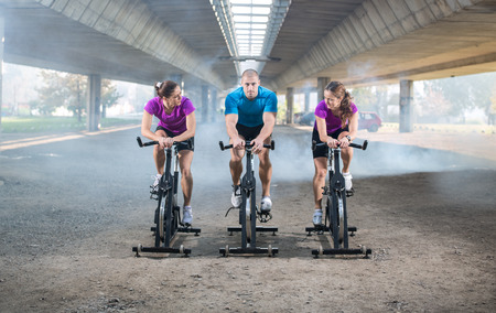 to spin: people riding exercise bikes