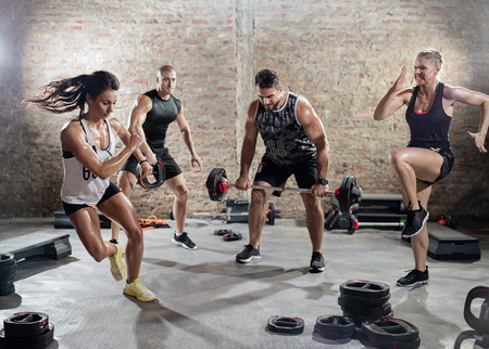 training: sporty people  practicing with weights, high intensity training