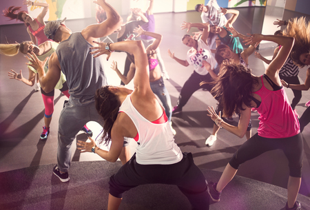 group of dancer at Zumba fitness training in studio Standard-Bild
