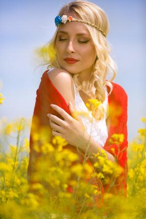 vertical wellness: Spring woman enjoy in canola field Stock Photo