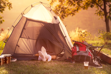 Young couple having in tent