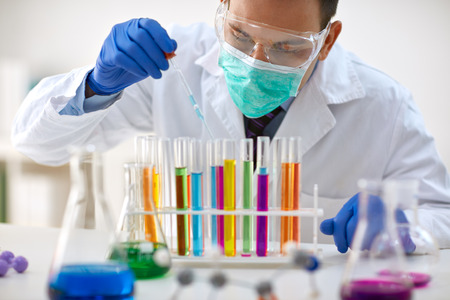 analyses: scientist work research and analyses content of test tubes- chemistry and research concept Stock Photo