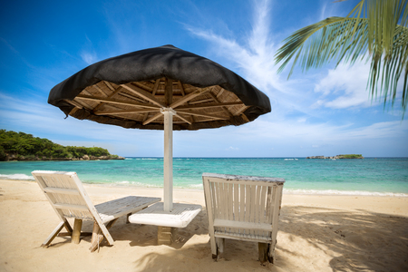 recliner: tropical beach, perfect place for relaxing, sun recliner in the shade of a palm tree
