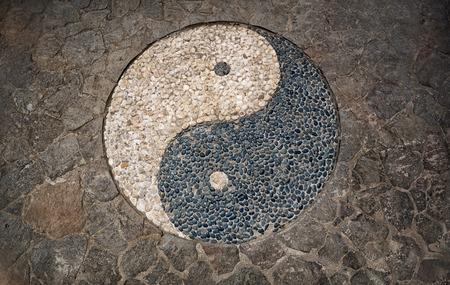 mosaic floor: Yin Yang Symbol in mosaic stone floor Stock Photo