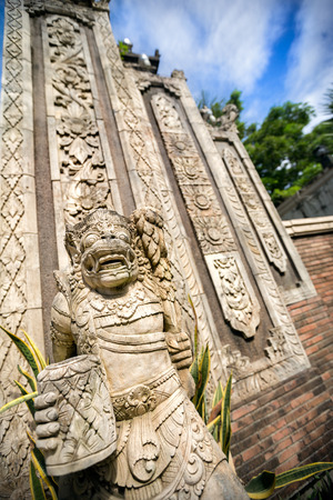 deities: Statues and carvings depicting demons, gods and Balinese mythological deities in Ubud, Bali.