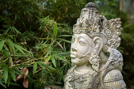 deities: Statues of Hindu god carvings in stone, Balinese mythological deities Stock Photo