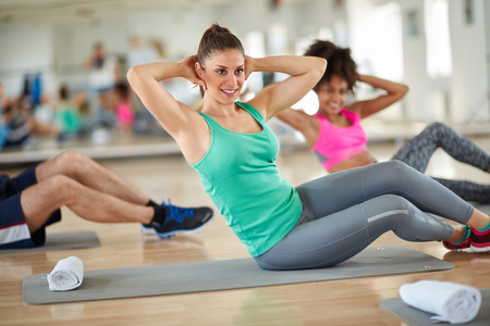 stretching condition: Young brunette on fitness training at gym Stock Photo
