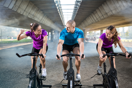to spin: group of people healthy exercise on spin bike Stock Photo