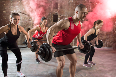 body pump: muscular people bodybuilders workout torso with dumbbell