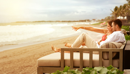 couple relaxing: Young couple relaxing on sunbed n beautiful beach