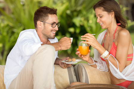 refreshment: Happy couple drinking refreshment on summer day Stock Photo