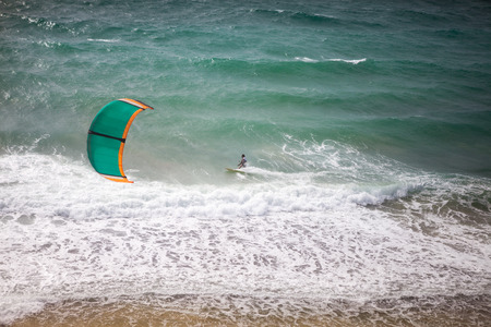 kite surfing: Kite surfing on a sunny day, kite surfer in action Stock Photo