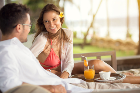 lovingly: Happy couple on vacation, smiling  girl lovingly watched her boyfriend