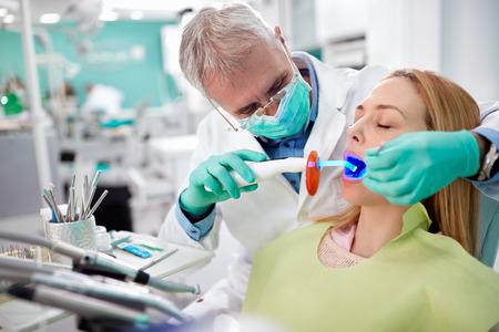 dental practice: Dentist use dental instrument with light in dental practice