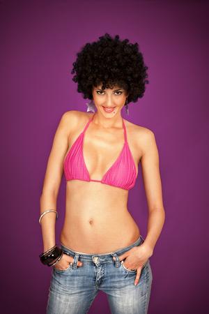 modern style, disco girl posing on studio background photo