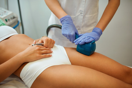 Skin and body care with treatment  at cosmetic beauty spa clinic, lifting, tightening, anti-cellulite, massage