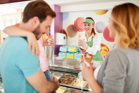 flavors: Family in pastry shop buying  ice cream different flavors