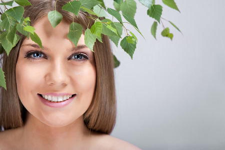 beautiful woman with green leaves, natural beauty