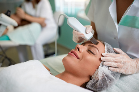 Cavitation peeling, beauty treatment on face,  womans face during a facial at a beauty salon
