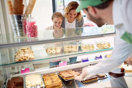 Customers, mother and daughter in pastry shop