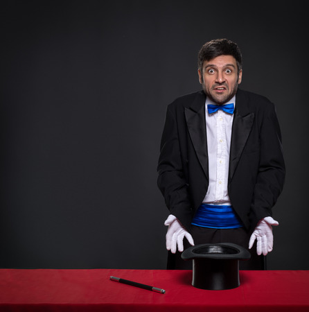 conjuror: disappointed magician without magic with facial expressions