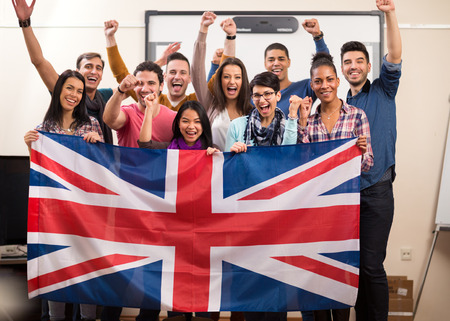 study group: Exited British students with raised fists present their team with flag