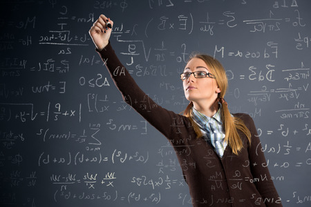 assignments: Schoolgirl work assignments in mathematics on transparent wall Stock Photo