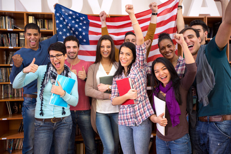 Group of happy students holding American flag and presenting their country