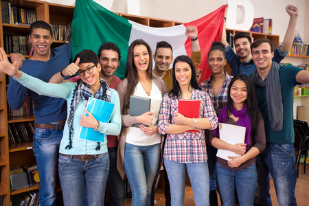languages: Multiethnic  cheerful students present Italy with flag