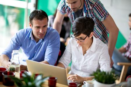 portrait of business presentation on laptop during coffee break