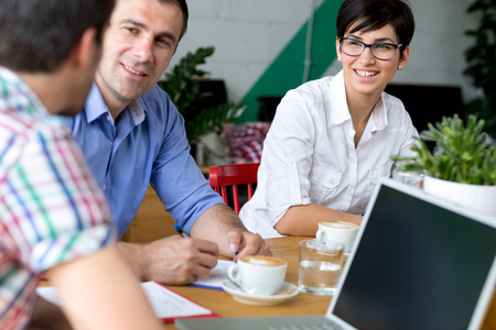 i pad: Business people using break in coffee shop Stock Photo