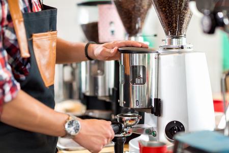 employed: Employed barista preparing coffee machine