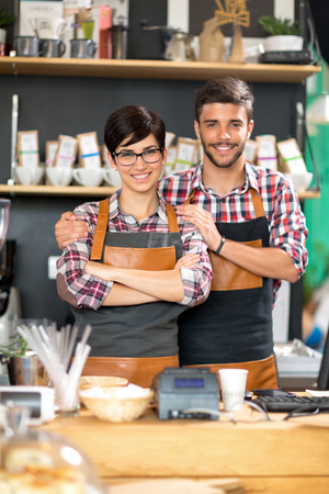 service man: smiling couple coffee shop owner Stock Photo