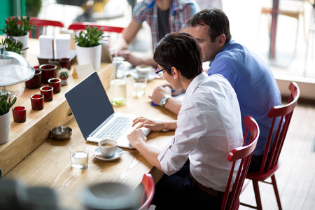 business attire teacher: portrait of business presentation on laptop at cafe Stock Photo