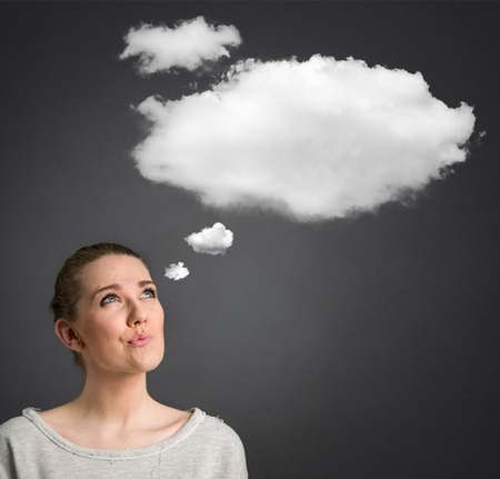 preguntando: young woman looking and thinking with cloud over her head
