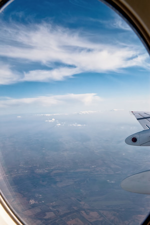 sky cloud: View of clouds and wing from airplane window
