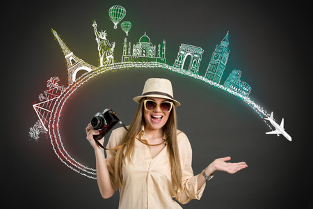 Excited Tourist with photo camera and  landmarks from different cities Imagens