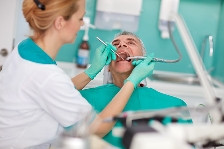Senior patient repairing tooth in dental clinic Stock Photo