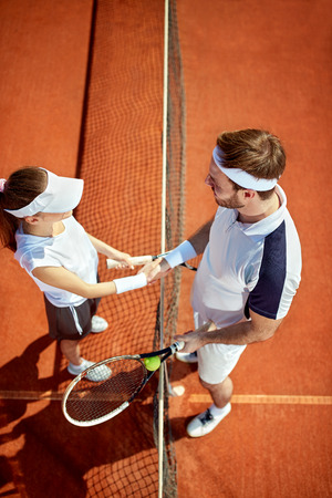congratulate: Tennis teacher congratulate to sportswoman after game