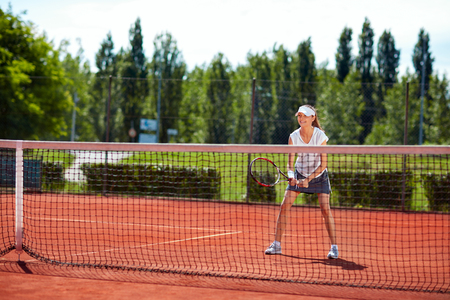 Young girl on tennis training in nature Stock Photo