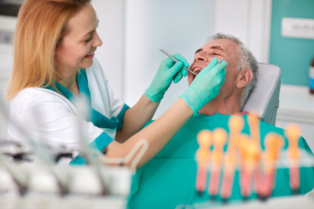 Senior male on check up at dentist Stock Photo