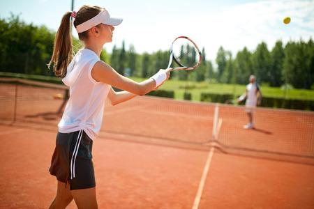 Girl play's tennis on open